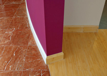 Marble tile and bamboo flooring installation. Curved wall, custom painting