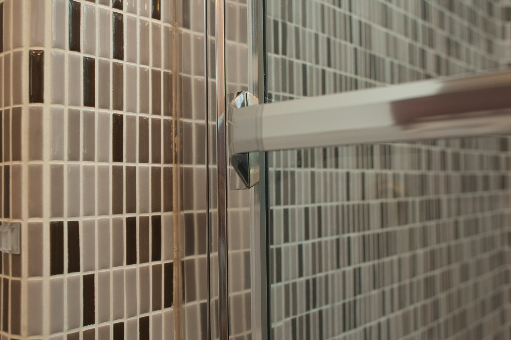 nexxus-remodel.bathroom.shower-tile-door-detail