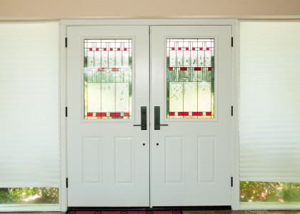 Double front doors with stained glass