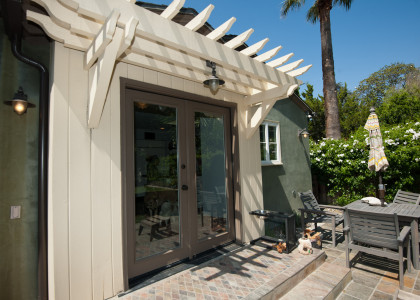 Patio with doors and architectural shade