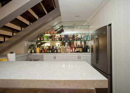 Bar tucked under stairs